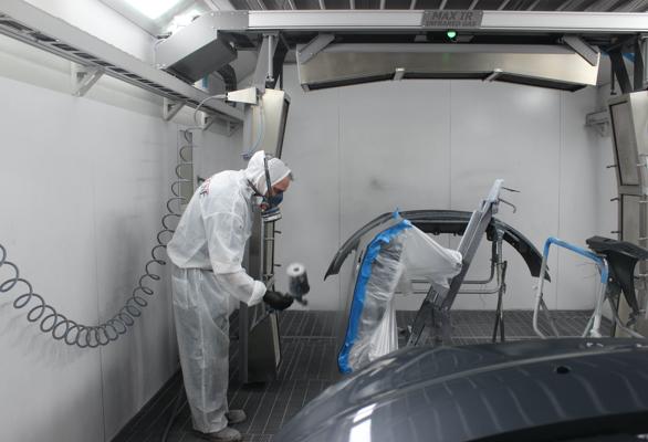 Person repainting car parts